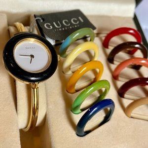 Gucci watch with color interchangeable rings.